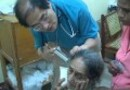 Dr. Kenneth Chan helps Elderly woman in Somoto, Nicaragua